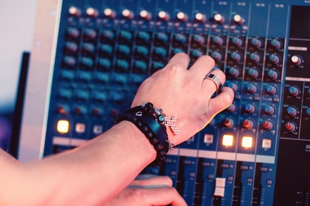 Musician hand tuning sound panel