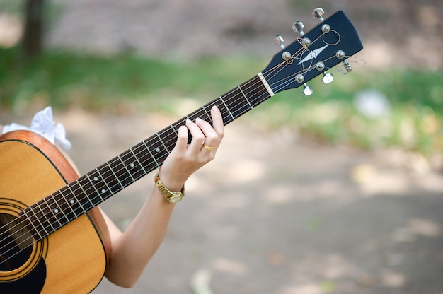 Musician hands and acoustic guitars, musical instruments with very good sound