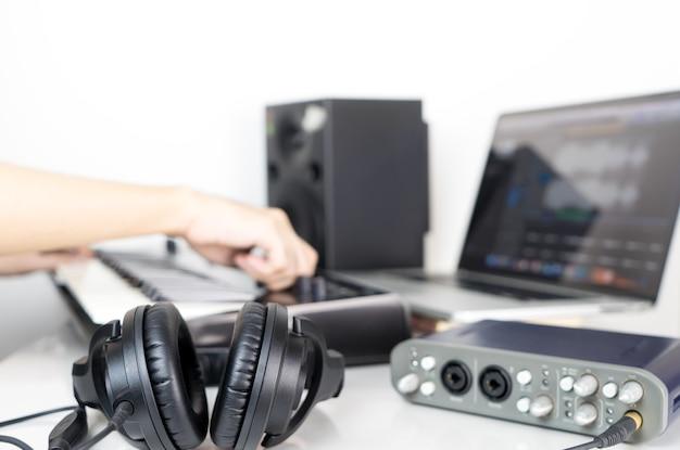 Musician is producing music on music studio working desktop