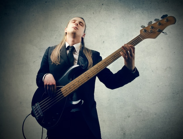 Musician playing on a guitar