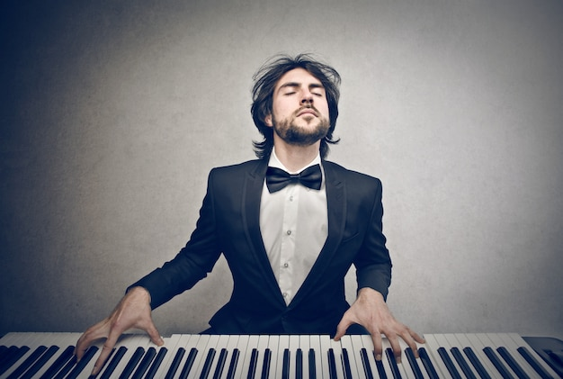 Musician playing on a piano
