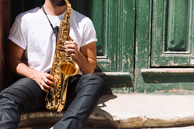 Musician playing the sax in the street