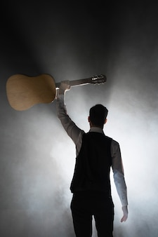 Musician on stage holding his classical guitar
