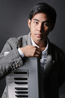 Musician with keyboard in studio