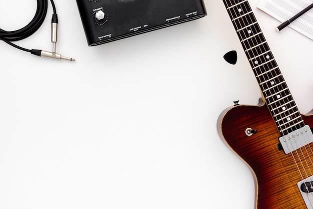 Musician work set with guitar, note and headphones