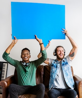 Musicians holding speech bubbles collaboration and music concept