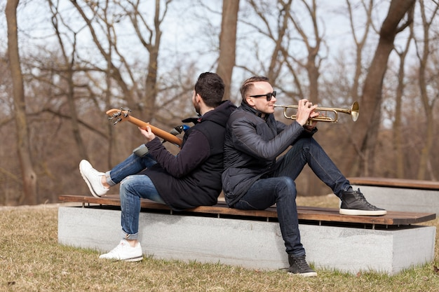 Musicians leaning against each other