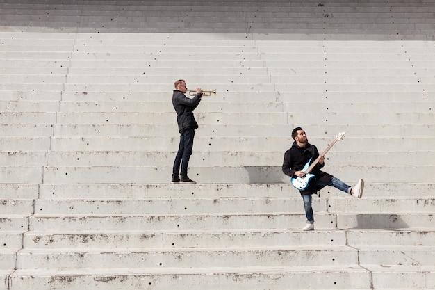 Musicians performing on concrete stais