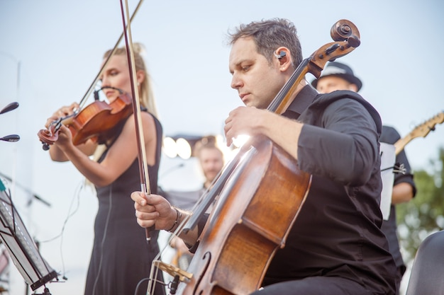 Musicians playing classical instrumental music on the street