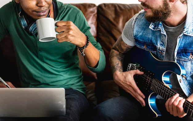 Musicians in a songwriting process holding collaboration and music concept
