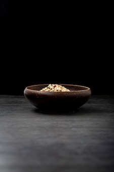 Musli bowl on a black background