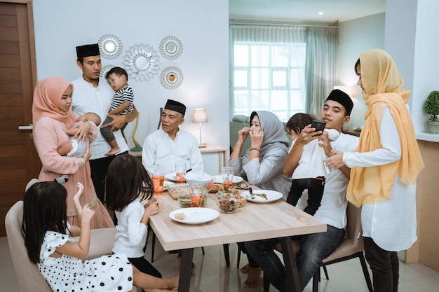 Muslim asian family and grandparents having break fasting on ramadan. iftar dinner break