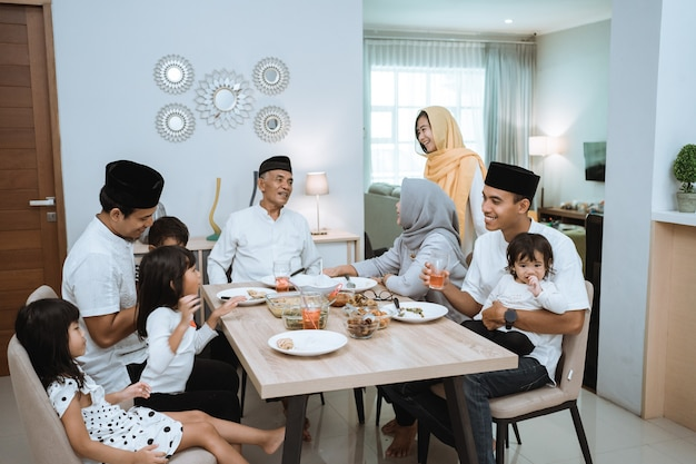 Muslim asian family and grandparents having break fasting on ramadan. iftar dinner break