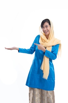 Muslim asian woman pointing at one side
