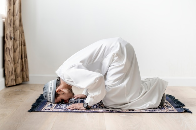 Muslim boy praying in sujud posture