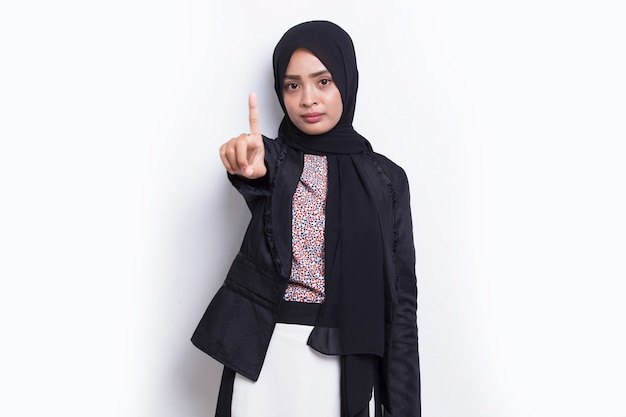 Muslim business woman with open hand doing stop sign with serious expression defense gesture