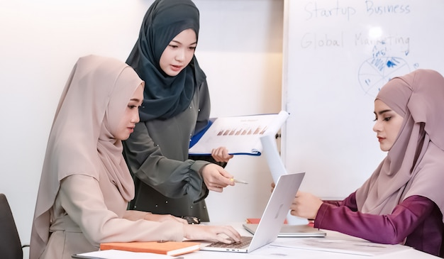 The muslim business women doing work together,at meeting room,busy time,at office,smart lady