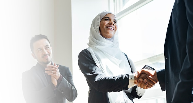 Muslim businesswoman shaking hands for a business agreement
