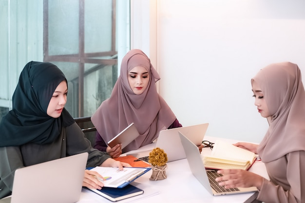 The muslim businesswomen doing work together,at meeting room,busy time