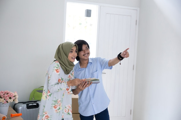 Muslim couple choosing paint for the wall