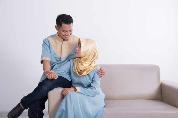 Muslim couple on a couch