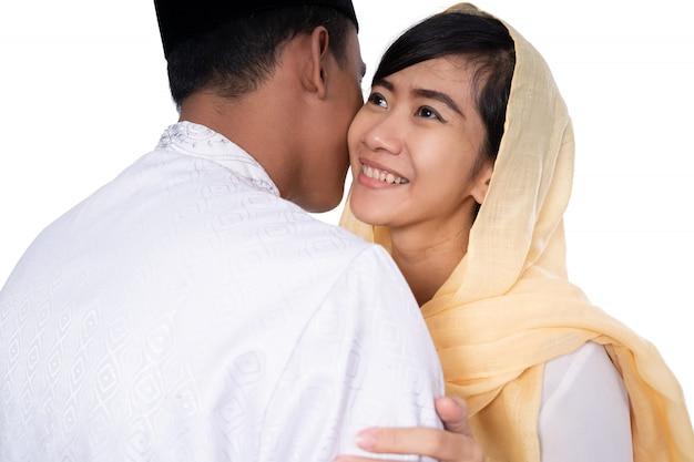 Muslim couple embrace on eid mubarak