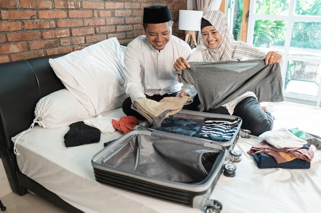 Muslim couple packing for holiday