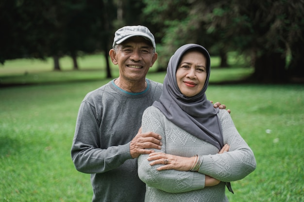 Muslim couple in the park smiling