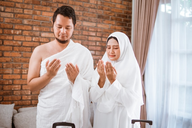 Muslim couple praying