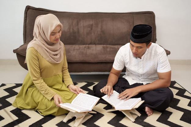Muslim couple reading holy quran