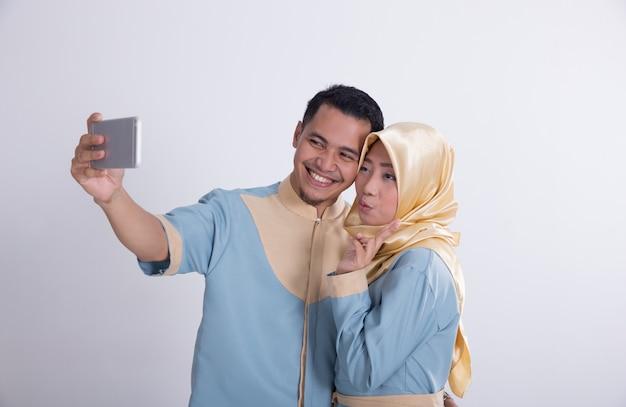 Muslim couple taking selfie