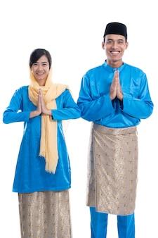 Muslim couple wishing you eid mubarak