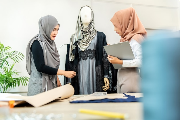 Muslim dressmakers working on their new collection
