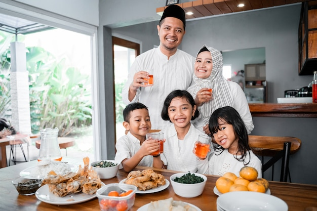 Muslim family breaking the fast