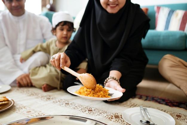 Muslim family having dinner on the floor