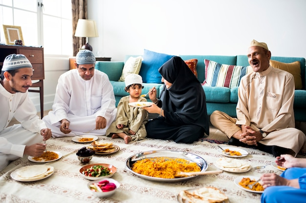 Muslim family having dinner on the floor