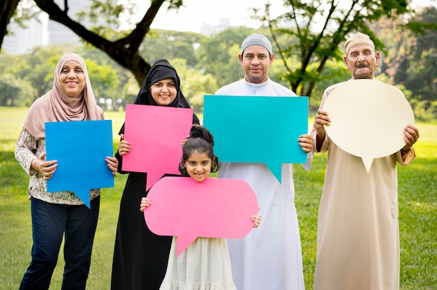 Muslim family holding up speech bubbles