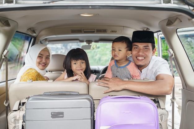 Muslim family travel by car during eid mubarak celebration