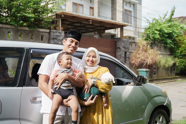 Muslim family travel by car during eid mubarak celebration