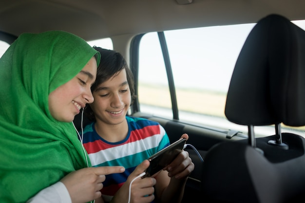Muslim family traveling with car