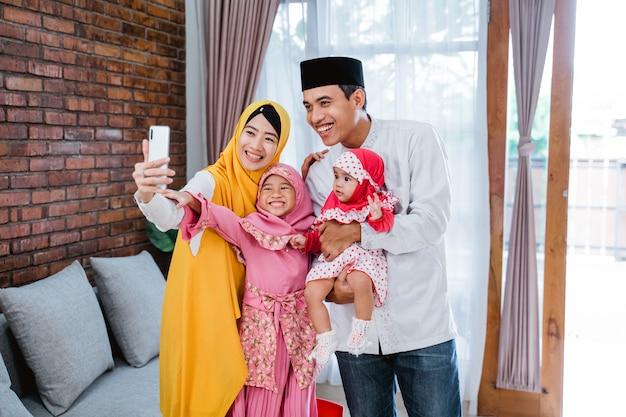 Muslim family video calling with relatives during eid mubarak