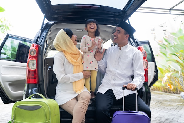 Muslim family with suitcase before traveling