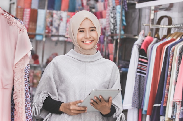 Muslim fashion boutique owner with tablet