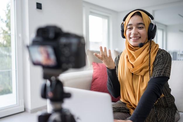 Muslim girl having video content streaming