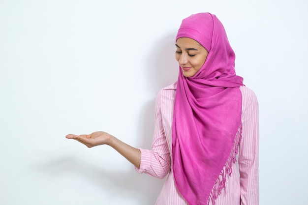Muslim girl in hijab shows her hands copy space