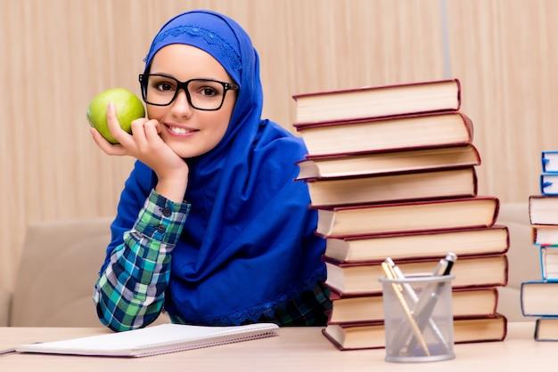 Muslim girl preparing for entry exams