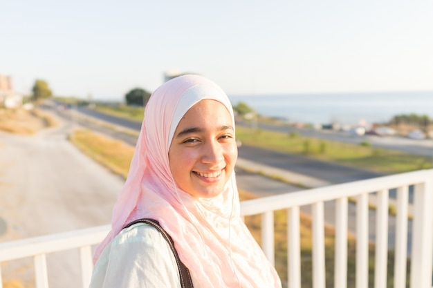 Muslim girl on sea coast