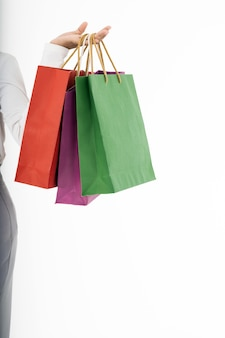 Muslim girl shopping bags closeup