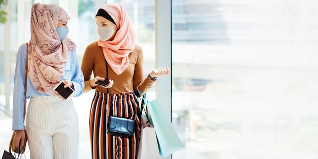 Muslim girls in face mask shopping at the mall in new normal