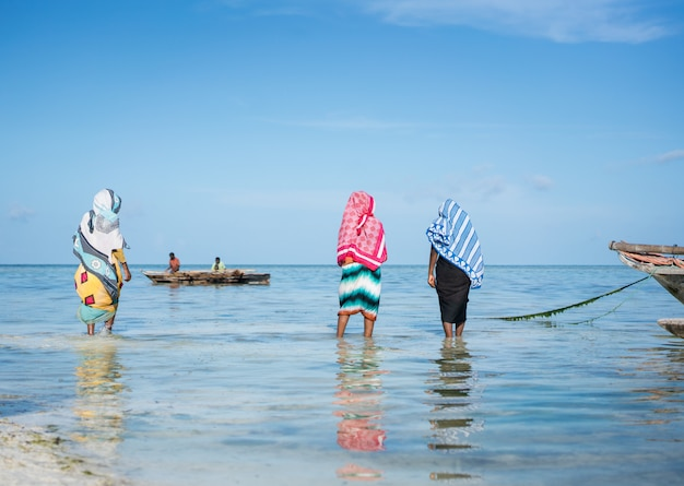 Muslim girls in tropical sea water